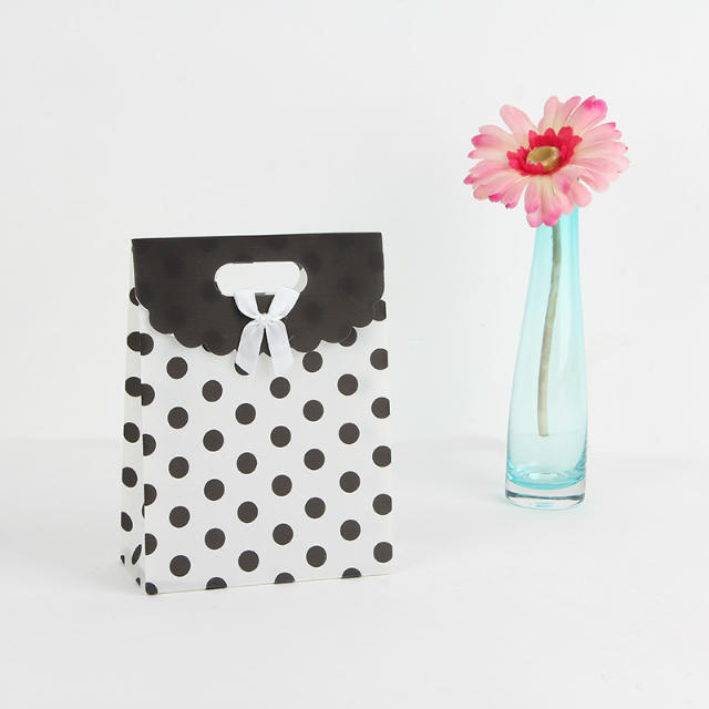 White black polka dot bag